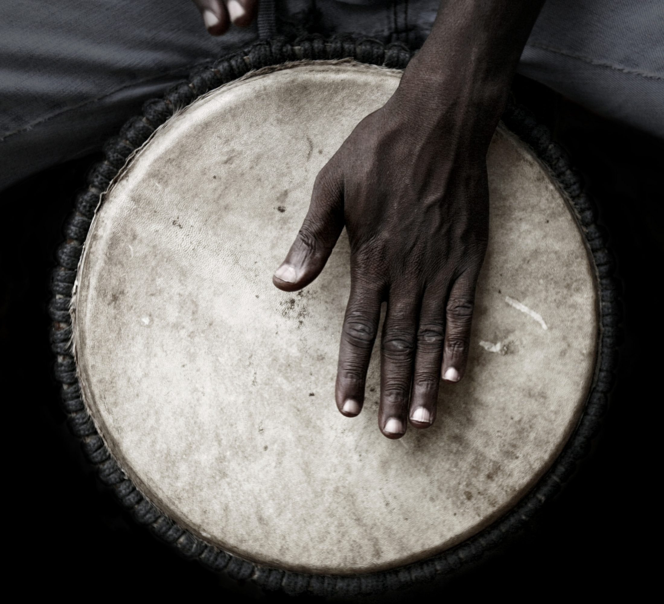 West African man palying djembe.